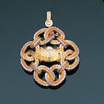 A fancy yellow diamond brooch/pendant,, by Buccellati