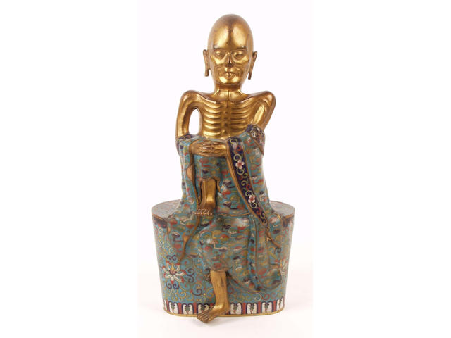 An early 20th Century cloisonne figure of an emaciated lohan