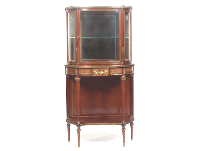 An early 20th Century Empire style mahogany and ormolu mounted half round display cabinet