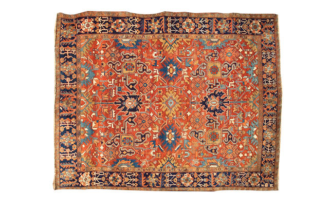 A Heriz carpet North West Persia, 10 ft 3 in x 8 ft 2 in (312 x 249 cm)