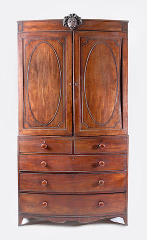 A George III mahogany bowfront linen press,