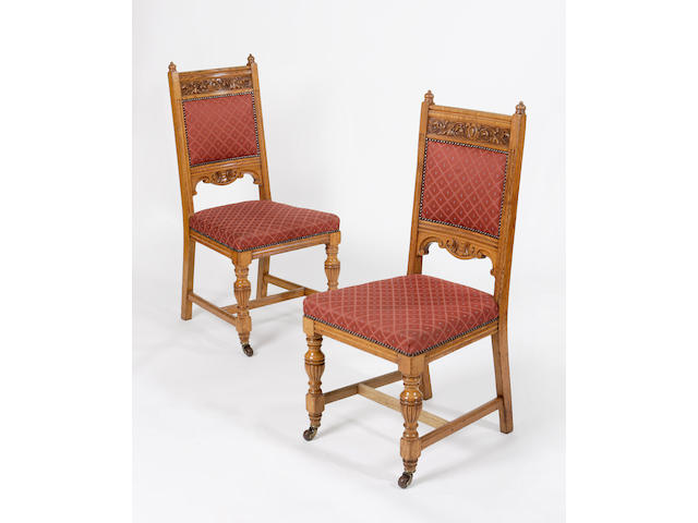 A set of twenty-nine late Victorian oak dining chairs,