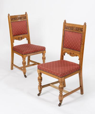 A set of twenty-nine late Victorian oak dining chairs,