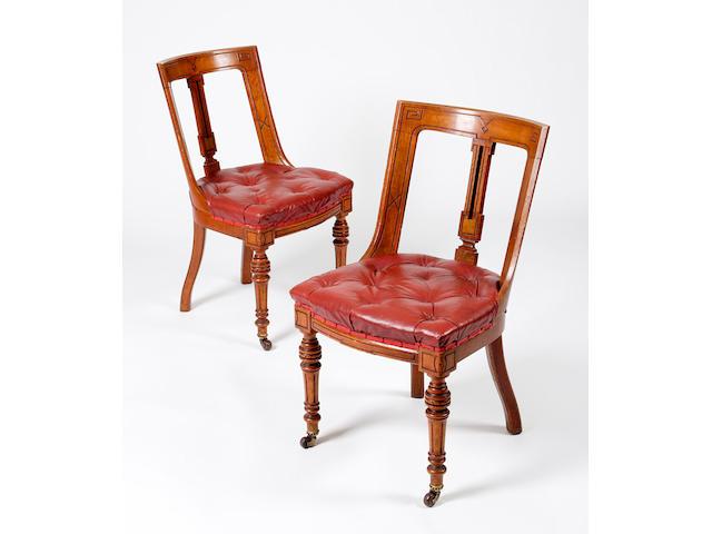 A set of twenty-three Victorian oak Trafalgar chairs,