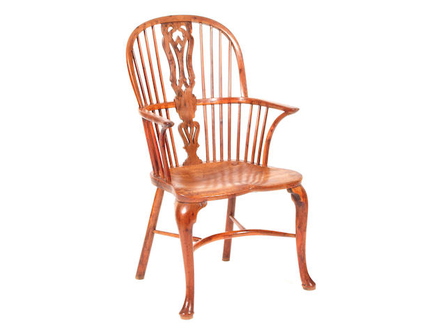 A 19th Century yew and elm Windsor elbow chair