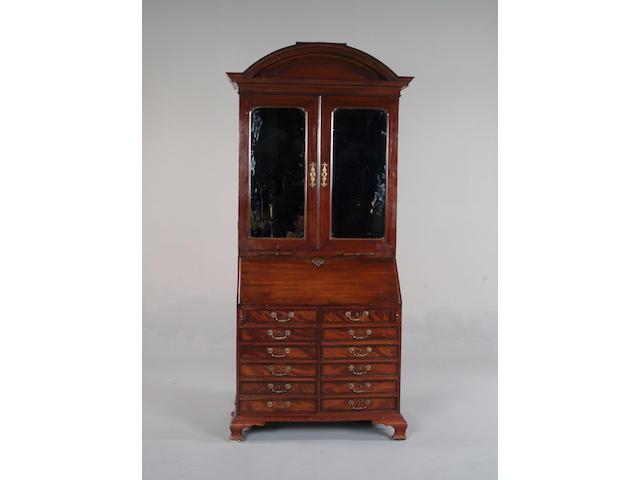 A mahogany bureau cabinet