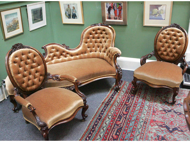 A Victorian carved walnut three piece Parlour Suite,