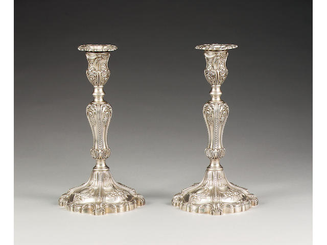 An Edwardian pair of silver candlesticks, by Hawksworth, Eyre Co. Ltd., Sheffield 1902,