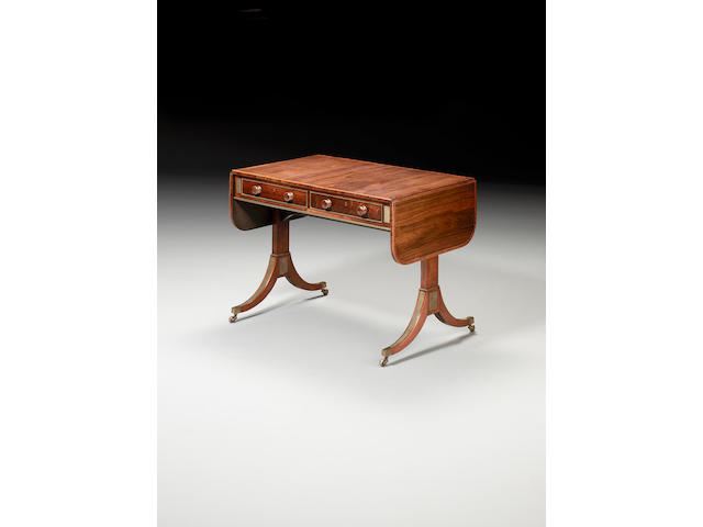 A Regency rosewood and brass bound sofa table attributed to John Maclean