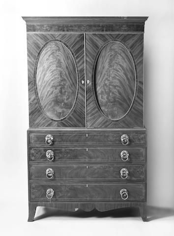 A 19th Century Channel Islands figured mahogany gentleman's press
