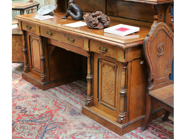 A large Aesthetic movement pollard oak sideboard