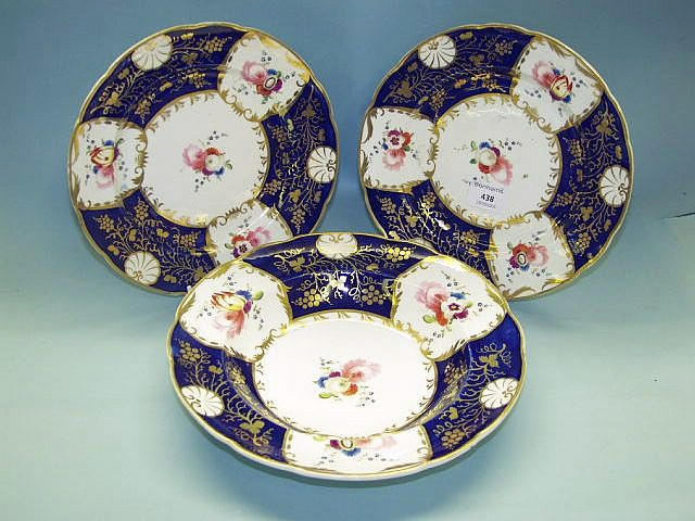 A pair of English porcelain plates and a matching soup plate early 19th Century,