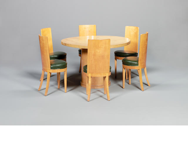 Gerald Summers, circa 1935 A Birch Laminate Circular Dining Table with Six associated Sycamore Dinin