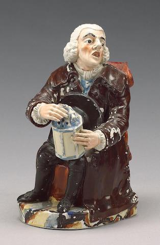 A pearlware 'Nightwatchman' Toby Jug, circa 1815-20