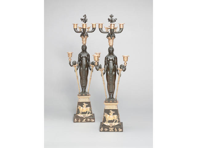 A pair of French gilt and patinated bronze five light figural Candelabra