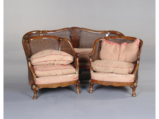 An early 20th century walnut and parcel gilt caned bergère suite in the Queen Anne taste