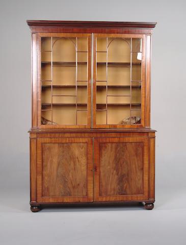 An early 19th century mahogany bookcase cabinet