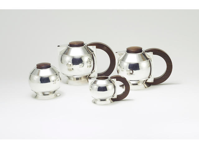 Jean Émile Puiforcat A Silver and Fruitwood Tea Set, circa 1925