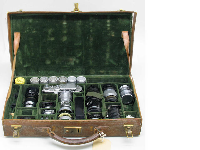 Leica cased outfit, a green felt lined fitted leather case containing a Leica IIIb.