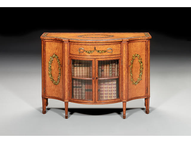 A late George III satinwood, rosewood crossbanded, tulipwood banded polychrome decorated serpentine secretaire Side Cabinetin the manner of Seddon Son and Shackleton