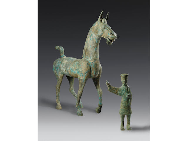 A massive and very rare bronze striding horse and groom Han Dynasty, probably Eastern