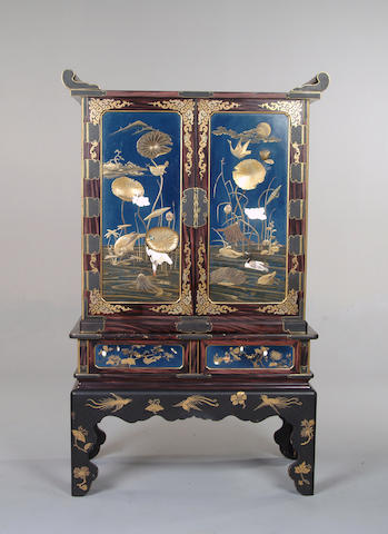 A blue lacquered and faux rosewood grained Japanese cabinet on stand