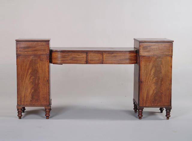 A George IV mahogany pedestal sideboard