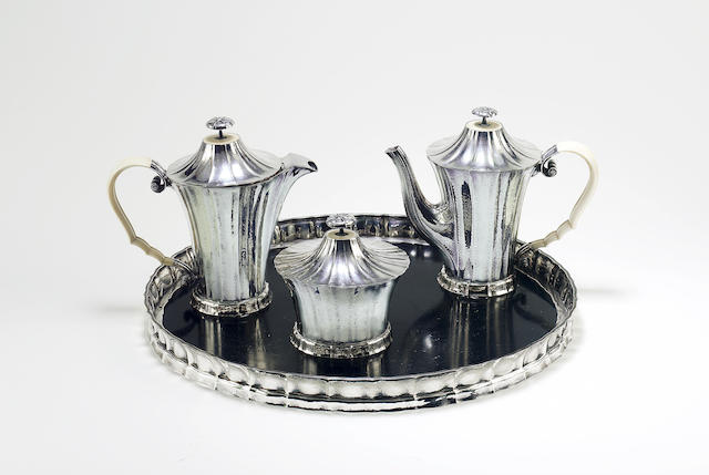 Josef Hoffmann for Wiener Werkstätte A Silver and Ivory Three Piece Tea Set and Matching Tray, circa 1922