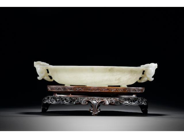 An important pale celadon jade shallow circular two-handled bowl Qianlong