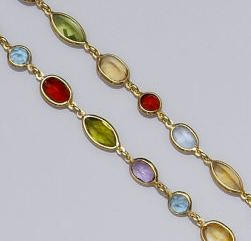 A multi-gem set spectacle chain,