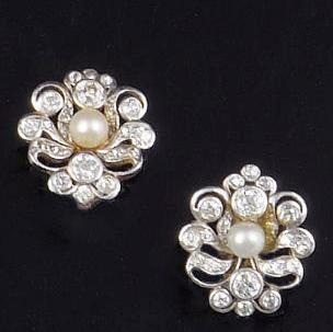 A pair of late Victorian diamond and pearl earstuds