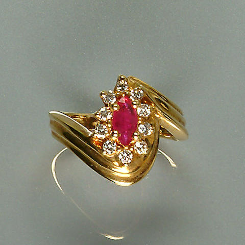 50208300013 A diamond and ruby set twist cluster ring