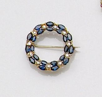 A sapphire and diamond circular hoop brooch,