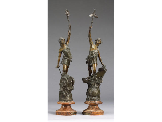 A pair of allegorical figures 'Automobilie' and 'Aviation' by Ferrand, circa 1907,