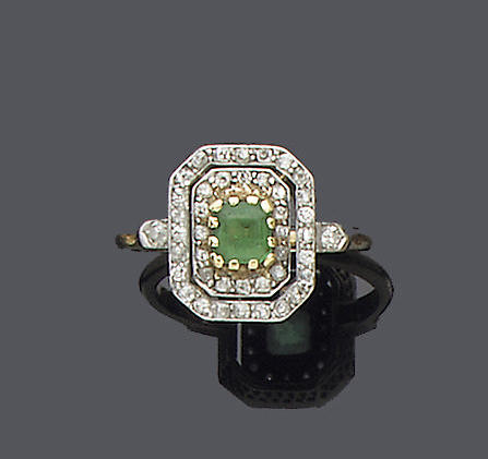 An early 20th century diamond and emerald dress ring,