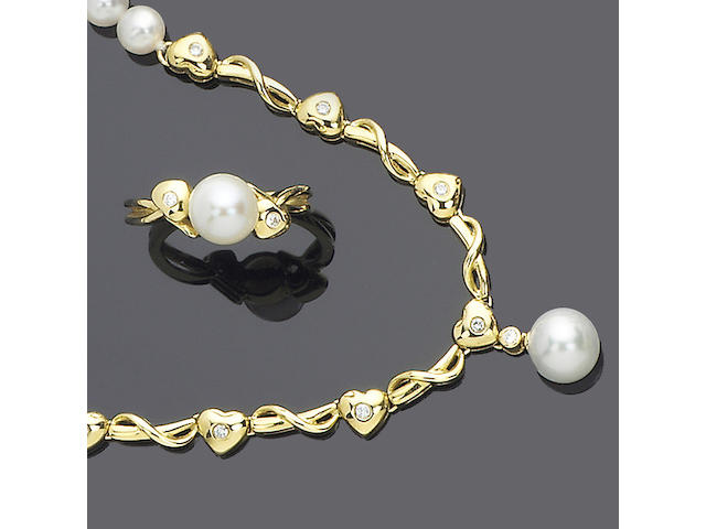 A freshwater cultured pearl and diamond demi-parure,