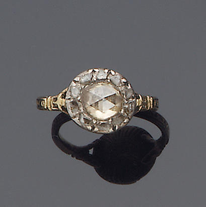A late 18th century diamond cluster mourning ring,