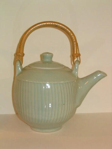 David Leach a fluted teapot Height to top of handle 8 1/4in. (21.5cm)