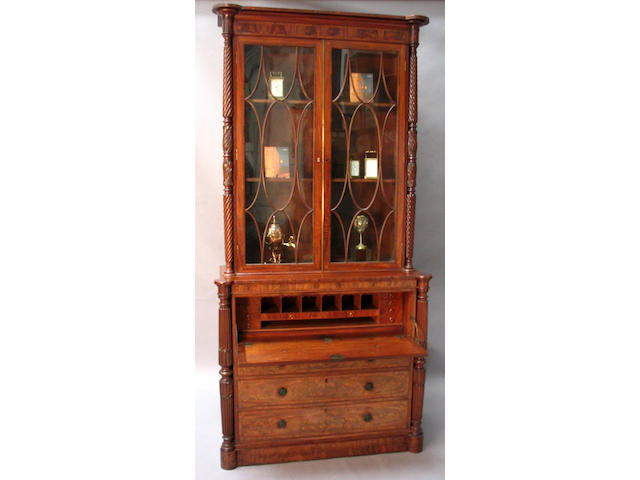 A George IV North Counties figured mahogany, rosewood crossbanded, floret and line inlaid secretaire bookcase