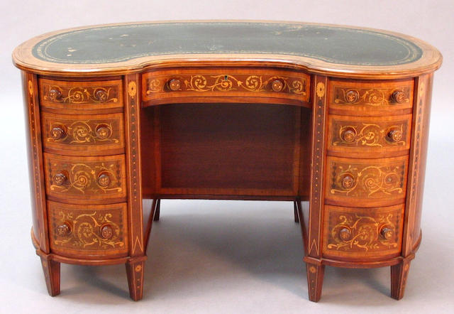 An Edwardian Sheraton revival mahogany, satinwood crossbanded, line and marquetry inlaid kidney shaped kneehole desk