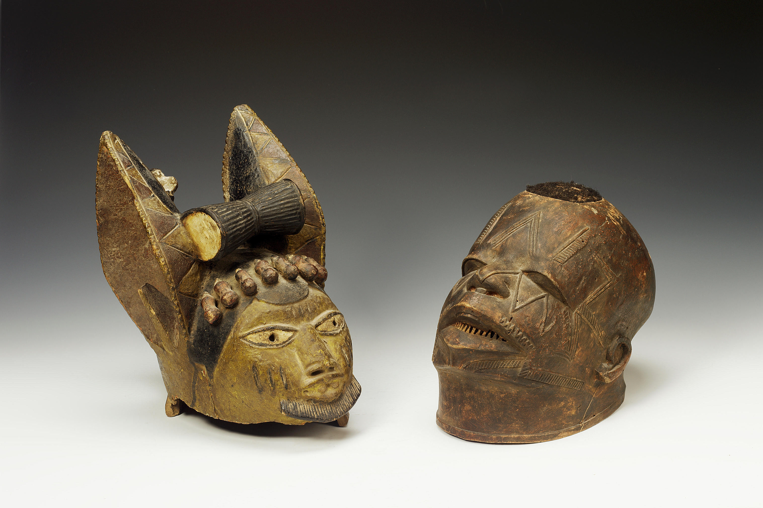 A Yoruba helmet mask and a Makonde mask