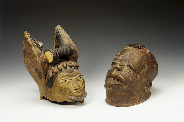 A Yoruba helmet mask and a Makonde mask 2