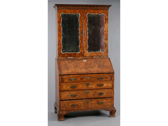An early 18th Century walnut bureau cabinet,
