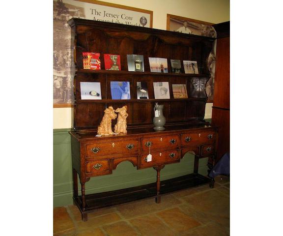 A late George III oak dresser