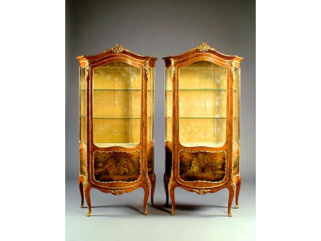 A pair of Louis XVI style ormolu mounted kingwood serpentine vitrines,