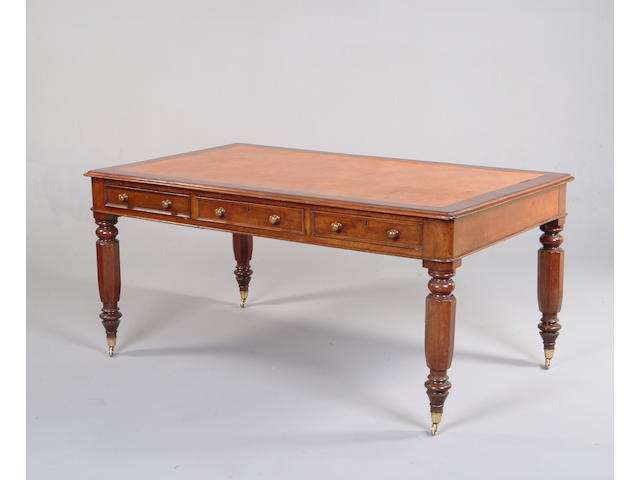 A Victorian mahogany library table