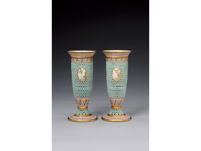 An important pair of Royal Worcester reticulated vases by George Owen dated 1889
