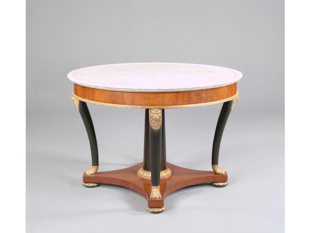 An Italian Empire walnut, ebonised and parcel gilt centre table