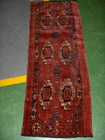A Tekke chuval West Turkestan 3 ft 10 in x 1 ft 4 in (116 x 41 cm)