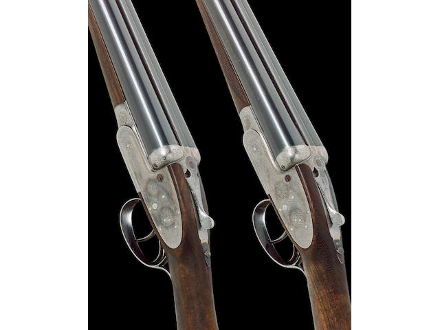 A pair of 12-bore self-opening sidelock ejector guns by J. Purdey, no. 18079/80 In their brass-mounted oak and leather case